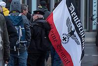 """Etwa 2.000 rechtsradikale Menschen demonstrierten am Samstag den 12. Maerz 2016 in Berlin unter dem Motto """"Merkel muss weg!"""" gegen Angela Merkel, gegen Fluechtlinge und fuer """"Das deutsche Vaterland"""".<br /> Bis auf wenige Ausnahmen waren angereisten Teilnehmer Neonazis und Hooligans, NPD-, Pediga- und AfD-Mitglieder.<br /> Aufgerufen zu dem Aufmarsch hatten die Hooligan-Gruppen """"Buendnis fuer Deutschland"""" und """"Buendnis fuer Berlin"""".<br /> Im Bild: Ein Demonstrationsteilnehmer mit einer Fahne in den Farben des Deutschen Reichs und einem Reichsadler, bei dem das Hakenkreuz im Kranz durch ein Eisernes Kreuz ersetzt wurde. An seiner Muetze traegt er einen Anstecker der Deutschland in den Grenzen von 1937 zeigt.<br /> 12.3.2016, Berlin<br /> Copyright: Christian-Ditsch.de<br /> [Inhaltsveraendernde Manipulation des Fotos nur nach ausdruecklicher Genehmigung des Fotografen. Vereinbarungen ueber Abtretung von Persoenlichkeitsrechten/Model Release der abgebildeten Person/Personen liegen nicht vor. NO MODEL RELEASE! Nur fuer Redaktionelle Zwecke. Don't publish without copyright Christian-Ditsch.de, Veroeffentlichung nur mit Fotografennennung, sowie gegen Honorar, MwSt. und Beleg. Konto: I N G - D i B a, IBAN DE58500105175400192269, BIC INGDDEFFXXX, Kontakt: post@christian-ditsch.de<br /> Bei der Bearbeitung der Dateiinformationen darf die Urheberkennzeichnung in den EXIF- und  IPTC-Daten nicht entfernt werden, diese sind in digitalen Medien nach §95c UrhG rechtlich geschuetzt. Der Urhebervermerk wird gemaess §13 UrhG verlangt.]"""