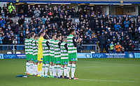 Yeovil players take part in a minutes applause for Graham Taylor who passed away during the Sky Bet League 2 match between Wycombe Wanderers and Yeovil Town at Adams Park, High Wycombe, England on 14 January 2017. Photo by Andy Rowland / PRiME Media Images.