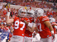 Ohio State Buckeyes defensive lineman Joey Bosa (97) celebrates his touchdown with Ohio State Buckeyes linebacker Darron Lee (43) and Ohio State Buckeyes defensive lineman Rashad Frazier (17) in the second quarter of the Big Ten Championship game at Lucas Oil Stadium in Indianapolis on Saturday, December 6, 2014. (Columbus Dispatch photo by Jonathan Quilter)