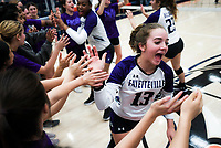 NWA Democrat-Gazette/CHARLIE KAIJO Fayetteville High School Gracyn Spresser (13) reacts after a win in three straight sets during a volleyball game, Thursday, October 11, 2018 at Rogers Heritage High School in Rogers.