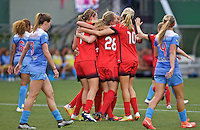 Portland, Oregon - Wednesday June 22, 2016: The Portland Thorns celebrate a goal during a regular season National Women's Soccer League (NWSL) match at Providence Park.