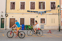 A cyclists on a street in the town of Rovinj, Istria County, Croatia