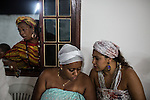 RIO DE JANEIRO, BRAZIL - JANUARY 24: Practitioners at a candomble ceremony, in Rio de Janeiro, Brazil, on Saturday, Jan. 23, 2015. Brazil's Afro-Brazilian religions which in recent years have come under increasing threats and prejudice, particularly from the growing number of evangelical churches. Candombl&eacute; originated in Salvador, Bahia at the beginning of the 19th century when enslaved Africans brought their beliefs with them. Umbanda and candombl&eacute; are Afro-Brazilian religions practiced in mostly Brazil. <br /> (Lianne Milton for the Washington Post)