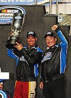 Nov. 15, 2008; Homestead, FL, USA; NASCAR Nationwide Series driver Clint Bowyer (left) and team owner Richard Childress celebrate after winning the 2008 championship following the Ford 300 at Homestead Miami Speedway. Mandatory Credit: Mark J. Rebilas-