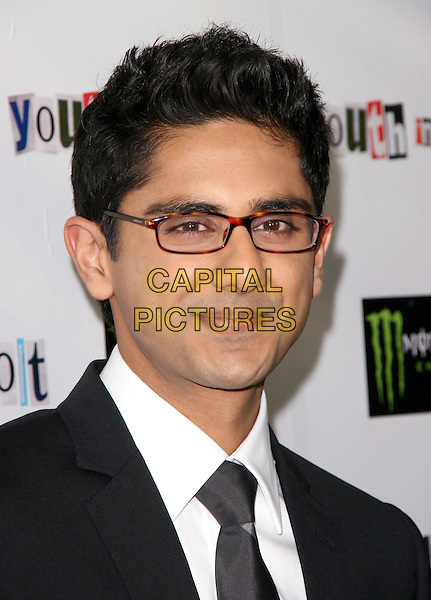 ADHIR KALYAN.The Weinstein Company Film premiere of ''Youth In Revolt'' held at The Mann Chinese 6 Theatre in Hollywood, California, USA..January 6th, 2010.headshot portrait black white glasses .CAP/RKE/DVS.©DVS/RockinExposures/Capital Pictures.