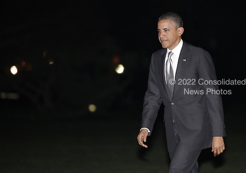 U.S. President Barack Obama walks on the South Lawn of the White House upon his return to Washington on  March 30, 2012. .Credit: Yuri Gripas / Pool via CNP
