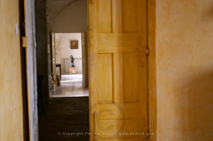 A corridor in the villa. Prieure de St Jean de Bebian. Pezenas region. Languedoc. The villa. A door. France. Europe.
