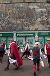 Dartford Kent, Morris dancers dancing under wall art mural depicting heritage trades of this town. 2019 UK