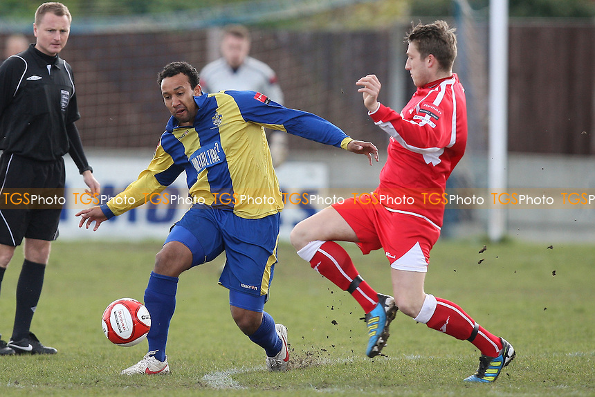Chris Sullivan of Romford is challenged by Sam Clarke - Romford vs AFC Sudbury - Ryman League Division One North Football at Mill Field, Aveley FC - 21/04/12 - MANDATORY CREDIT: Gavin Ellis/TGSPHOTO - Self billing applies where appropriate - 0845 094 6026 - contact@tgsphoto.co.uk - NO UNPAID USE.