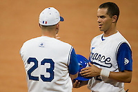 20 August 2007: #2 Sebastien Herve listens to coach Joshua Ridgway during the Czech Republic 6-1 victory over France in the Good Luck Beijing International baseball tournament (olympic test event) at the Wukesong Baseball Field in Beijing, China.
