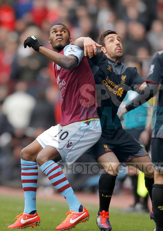 Christian Benteke of Aston Villa (left) competes with Jose Enrique of Liverpool -  Aston Villa vs Liverpool - Barclays Premiership  - Villa Park Birmingham -  Season 12/13 - 31/3/13.Photograph Malcolm Couzens/Sportimage