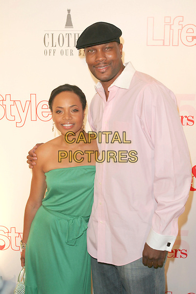 DWAYNE ADWAY & GUEST.Attends Life & Style Magazine Presents Stylemakers 2005 held at the Monmartre Lounge, Hollywood, California. USA, 26 May 2005. .Half length cap hat the rock green dress strapless arm around shoulder.Ref: ADM.www.capitalpictures.com.sales@capitalpictures.com.©Zach Lipp /AdMedia/Capital Pictures.