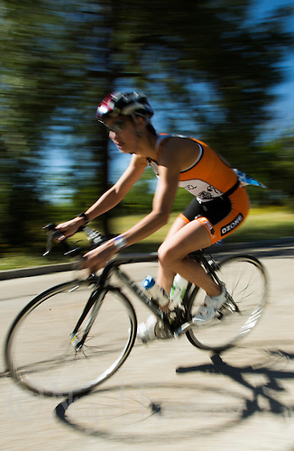 01 JUN 2013 - MADRID, ESP - A competitor makes her way around the Casa de Campo cycle course in Madrid, Spain during the WTP Agemaster race (PHOTO (C) 2013 NIGEL FARROW)