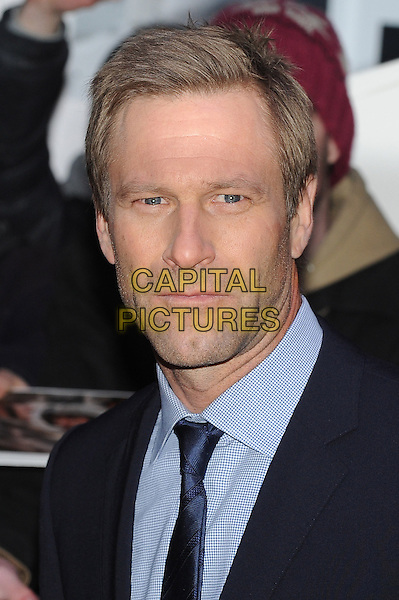 Aaron Eckhart .The UK premiere of 'Olympus Has Fallen', BFI Imax, London, England..3rd April 2013.headshot portrait black blue shirt tie suit .CAP/BEL.©Tom Belcher/Capital Pictures.