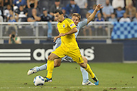 Matt Besler Sporting KC defender trird to tackle Dilly Duka (11) Columbus Crew... Sporting Kansas City defeated Columbus Crew 2-1 at LIVESTRONG Sporting Park, Kansas City, Kansas.