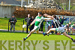Paul Kennedy Listry gets in his shot under pressure from Damian O'Sullivan Legion in Direen on Sunday