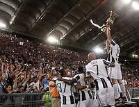 Calcio, finale Tim Cup: Milan vs Juventus. Roma, stadio Olimpico, 21 maggio 2016.<br /> Juventus&rsquo; Leonardo Bonucci, right, and his teamates show the trophy to fans at the end of the Italian Cup final football match between AC Milan and Juventus at Rome's Olympic stadium, 21 May 2016. Juventus won 1-0 in the extra time.<br /> UPDATE IMAGES PRESS/Isabella Bonotto
