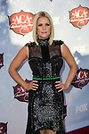 Carrie Keagan arrives at the American Country Awards 2013 at the Mandalay Bay Resort & Casino in Las Vegas, Nevada
