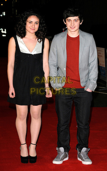 "YASMIN PAIGE & CRAIG ROBERTS .At the UK Film Premiere of ""Submarine"", BFI Southbank, London, England, UK, .March 15th 2011..full length black platform shoes dress grey gray jacket trainers brown top  hands in pockets trainers .CAP/CAN.©Can Nguyen/Capital Pictures."