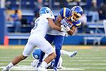BROOKINGS, SD - SEPTEMBER 10:  Marquise Lewis #11 from South Dakota State is brought down by Terry Wallen #5 from Drake during their game at the Dana J. Dykhouse Stadium Saturday night in Brookings. (Photo by Dave Eggen/Inertia)