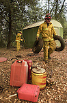 August 20, 2001 Coulterville, California  -- Creek Fire – Fire Captain Robert Hoyer and firefighter Josh Garcia clear around residence on Jackass Ridge Road before fire gets there. The Creek Fire burned 11,500 acres between Highway 49 and Priest-Coulterville Road a few miles north of Coulterville, California.
