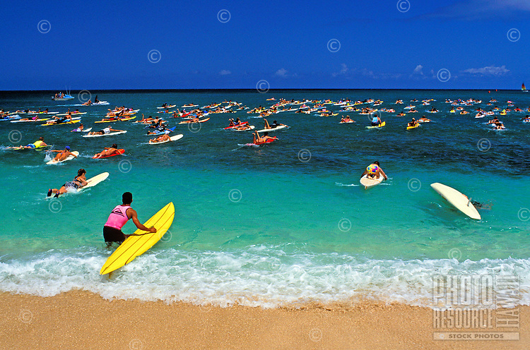 Surfboard paddle race on sunset beach of north shore Oahu
