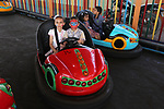 Palestinian children ride bumper car at an amusement park on the third day of Eid al-Fitr holiday which marks the end of the Muslim holy month of Ramadan, in Gaza City on June 27, 2017. Photo by Ashraf Amra