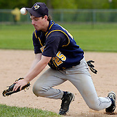 Photo by: Lawrence McKee<br /> Hats off: Detroit Country Day first baseman Mark Margolis utilizes every part of his uniform to knock down a ground ball during baseball action against Bloomfield Hills Lahser at Lahser Tuesday afternoon.