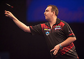 21.12.2014.  London, England.  William Hill World Darts Championship.  Kim Huybrechts (18) [BEL] in action during his game with Mickey Mansell [NIR]. Huybrechts won the match 3-0.