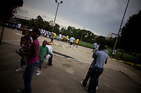 girls watch  a basketball tournament organized by a local pastor in Roseland, Chicago, Illinois, United States on Wednesday August 6 2008..The pastor promotes sports as a way to defeat violence..Senator Barack Obama, the 2008 democratic party presidential candidate, begun his political career by being an organizer in these neighborhoods..Roseland and other South Side neighborhoods of Chicago are among the most violent and segregated in the country.