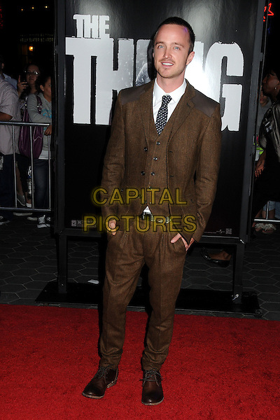 "Aaron Paul.""The Thing"" World Premiere held at AMC Citywalk Stadium 19, Universal City, California, USA..October 10th, 2011.full length brown suit waistcoat hands in pockets .CAP/ADM/BP.©Byron Purvis/AdMedia/Capital Pictures."