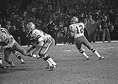 Dallas Cowboys quarterback Roger Staubach (12) looks for a received during the NFC Championship game against the Washington Redskins at RFK Stadium in Washington, DC on December 31, 1972.  Defending in front of him are left tackle Ralph Neely (73), center Dave Manders (51), and running back Calvin Hill (35). The Redskins won the game and the right to play in Super Bowl VII by a score of 26 - 3.<br /> Credit: Arnie Sachs / CNP