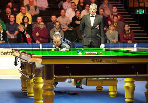 14.01.2013 London, England. John Higgins OBE (SCO) in action against Allistair Carter (ENG) during the Masters Snooker from Alexandra Palace.