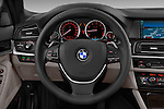 Steering wheel view of a 2013 Bmw SERIES 5 ActiveHybrid 5 4 Door Sedan 2WD
