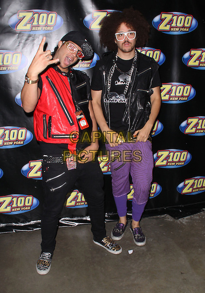SKY BLU & RED FOO.Z100's Zootopia 2009 Concert Rocks The IZOD Center, East Rutherford, NJ, USA..May 16th, 2009.full length jeans denim red black leather mouth open hand posing glasses.CAP/ADM/PZ.©Paul Zimmerman/AdMedia/Capital Pictures.