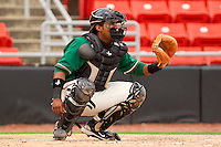 Catcher Wilfredo Gimenez #25 of the Greensboro Grasshoppers on defense against the Hickory Crawdads at L.P. Frans Stadium on May 18, 2011 in Hickory, North Carolina.   Photo by Brian Westerholt / Four Seam Images