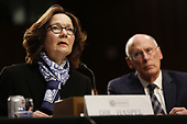"""Director Gina Haspel, Central Intelligence Agency (CIA) testifies before the United States Senate Select Committee on Intelligence during an open hearing on """"Worldwide Threats"""" on Capitol Hill in Washington, DC on Tuesday, January 29, 2019.  Looking on from the right is Director Daniel Coats, Office of the Director of National Intelligence (ODNI).<br /> Credit: Martin H. Simon / CNP"""