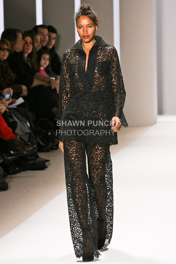 Arlenis Sosa walks the runway in a black lace pantsuit, by Georges Chakra for the Edition Autumn Winter 2010-2011 collection, during Mercedes-Benz Fashion Week Fall 2010.