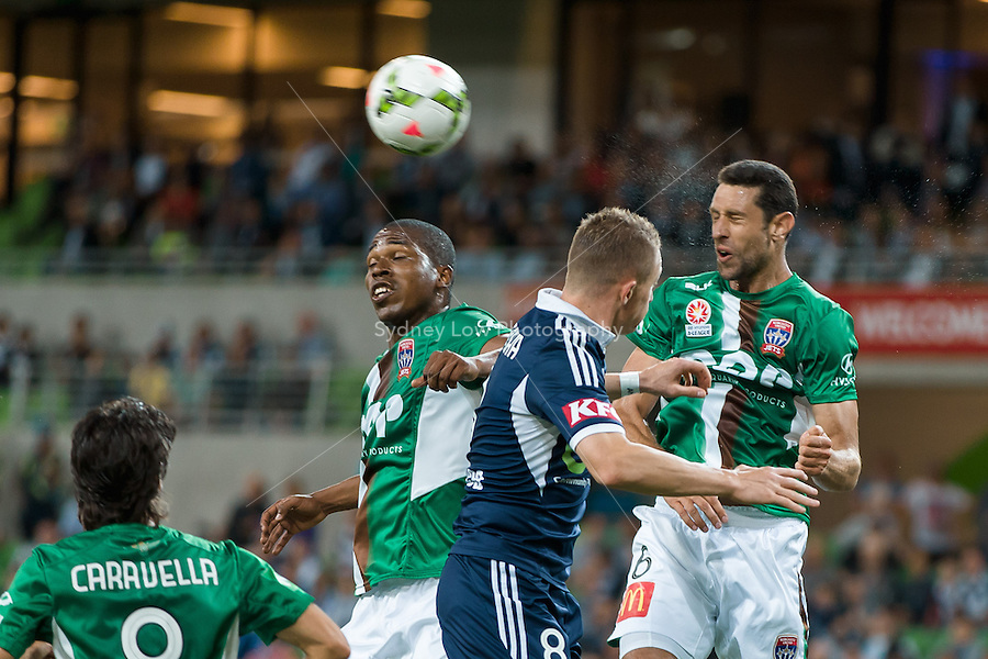 Players jump for the ball in a round 12 A-League match between Melbourne Victory and Newcastle Jets at AAMI Park in Melbourne, Australia during the 2014/2015 Australian A-League season. Melbourne def Newcastle 1-0