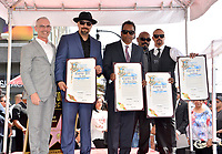 LOS ANGELES, CA. April 18, 2019: Cypress Hill, B Real, Eric Bobo Correa, Sen Dog, DJ Muggs &amp; Mitch O'Farrell at the Hollywood Walk of Fame Star Ceremony honoring hip-hop group Cypress Hill.<br /> Pictures: Paul Smith/Featureflash