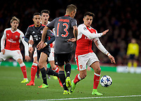 Alexis Sanchez of Arsenal and Rafinha of Bayern Munich during the UEFA Champions League round of 16 match between Arsenal and Bayern Munich at the Emirates Stadium, London, England on 7 March 2017. Photo by Alan  Stanford / PRiME Media Images.