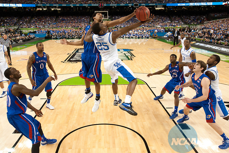 2 APR 2012: Guard Marquis Teague (25) from the University of Kentucky has his shot attempt blocked by forward Kevin Young (40) from the University of Kansas during the Championship Game of the 2012 NCAA Men's Division I Basketball Championship Final Four held at the Mercedes-Benz Superdome hosted by Tulane University in New Orleans, LA. Kentucky defeated Kansas 67-59 to claim the championship title. Chris Steppig/ NCAA Photos.