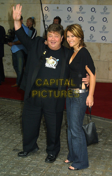 JONO COLEMAN, HARRIET SCOTT.Nordoff-Robbins Silver Clef Awards at the Hotel Inter-Continental.www.capitalpictures.com.sales@capitalpictures.com.© Capital Pictures..full length, full-length, waving