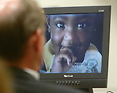 A home video showing one of the children of convicted sniper John Allen Muhammad is displayed on a screen during the penalty phase of the trial of convicted sniper John Allen Muhammad courtroom 10 at the Virginia Beach Circuit Court in Virginia Beach, Virginia on November 20, 2003.<br /> Credit: Lawrence Jackson - Pool via CNP