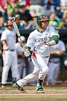 Miami Hurricanes designated hitter Garrett Kennedy (40) follows through on his swing during the NCAA College baseball World Series against the Arkansas Razorbacks  on June 15, 2015 at TD Ameritrade Park in Omaha, Nebraska. Miami beat Arkansas 4-3. (Andrew Woolley/Four Seam Images)