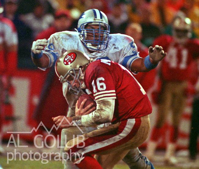 San Francisco 49ers vs. Detroit Lions at Candlestick Park Monday, December 28, 1992.  49ers Beat Lions 24-6.  Detroit Lions defensive end Tracy Scroggins (59) sacks San Francisco 49ers quarterback Joe Montana (16).