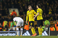 Son Heung-Min of Tottenham Hotspur (left) looks dejected as Lukasz Piszczek of Borussia Dortmund (centre) and Neven Subotic of Borussia Dortmund (right) celebrate victory after the UEFA Europa League match between Tottenham Hotspur and Borussia Dortmund at White Hart Lane, London, England on 17 March 2016. Photo by David Horn / PRiME Media Images