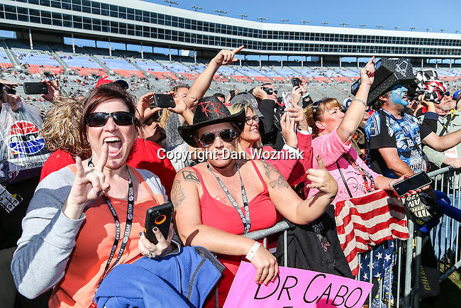 Fans watch the concert before the NASCAR AAA Texas 500 race at Texas Motor Speedway in Fort Worth,Texas.