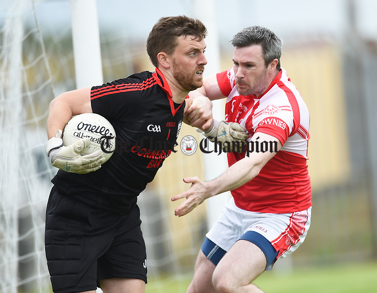 Padraig Brennan of Ennistymon in action against Barry Toner of Eire OG during their game in Miltown. Photograph by John Kelly.