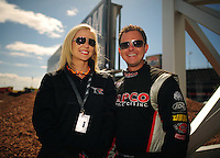 Apr. 1, 2012; Las Vegas, NV, USA: NHRA top fuel dragster driver Steve Torrence with his girlfriend during the Summitracing.com Nationals at The Strip in Las Vegas. Mandatory Credit: Mark J. Rebilas-